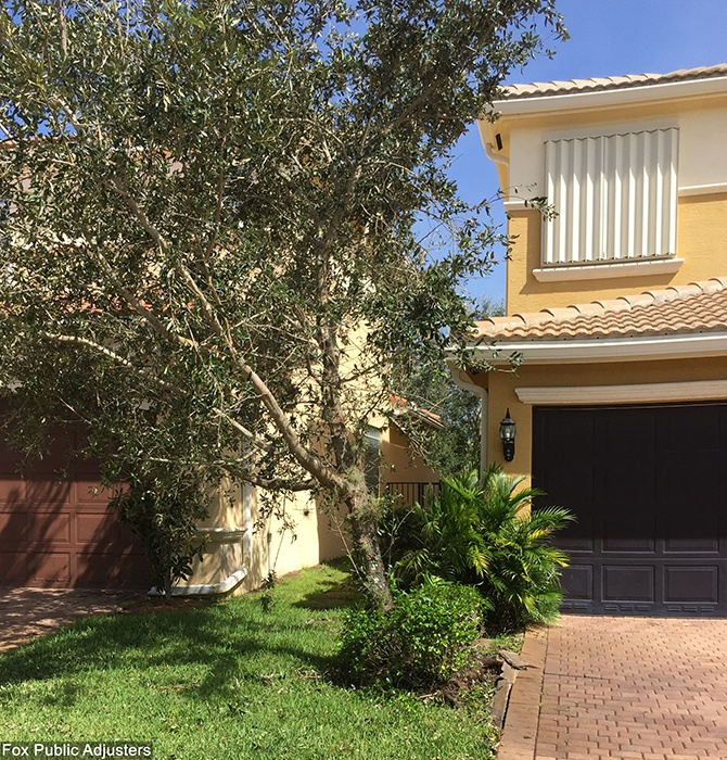Boynton Beach home protected with sliding hurricane shutters.