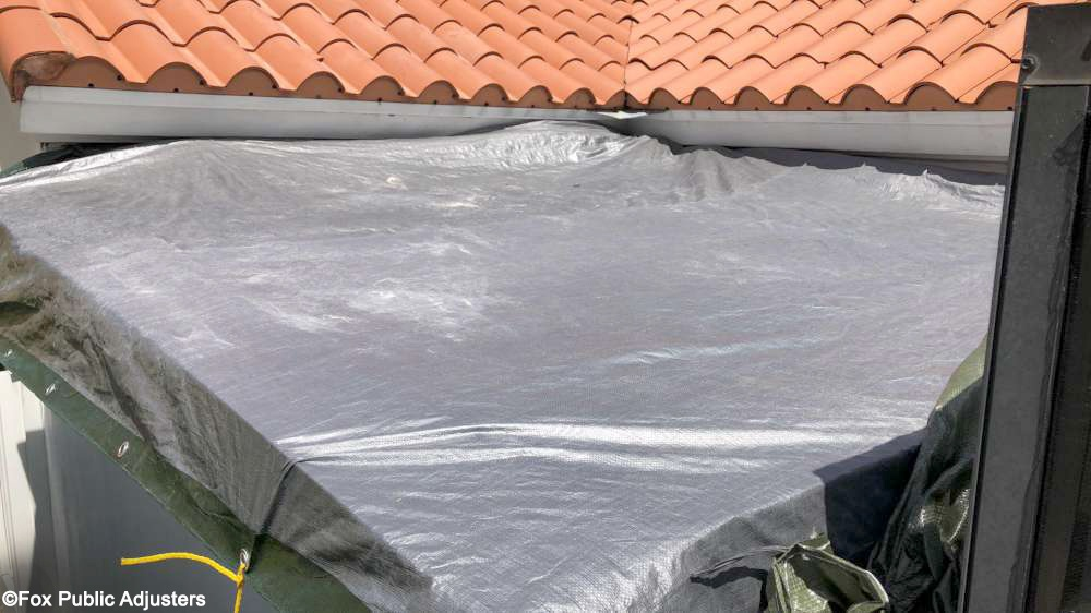 Roof leak between two roof sections in Palm Beach County